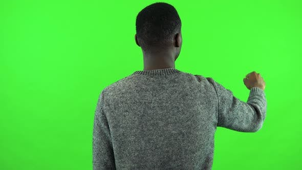 Thumbnail for A Black Man Works on an Interactive Board - Green Screen Studio