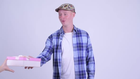 Thumbnail for Young Handsome Hipster Man Opening Empty Gift Box As Prank