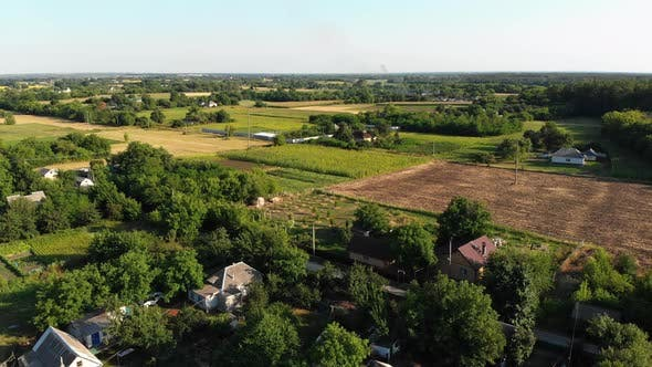 Thumbnail for Aerial View of the Countryside and Small Village with Green Fields and Meadows