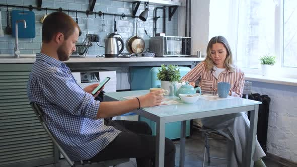 Thumbnail for Young Couple Have Breakfast in Modern Kitchen. Tea Cup. Breakfast at Morning