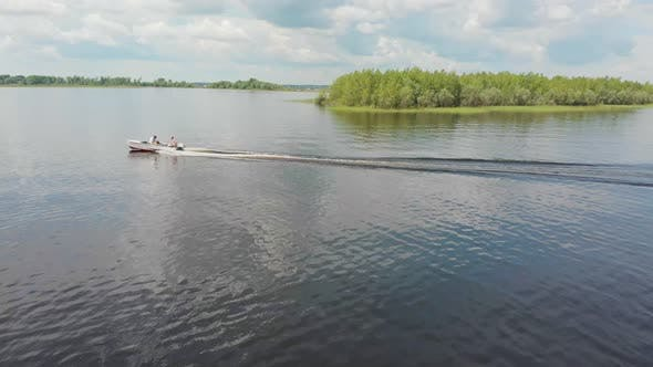 Thumbnail for Two Men Riding Motor Boat on River