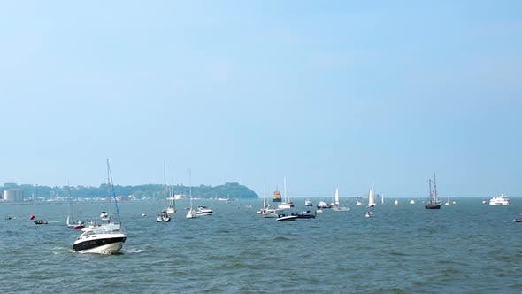 Thumbnail for Marine view of sea harbor with sailing boats, motorboats floating on waves