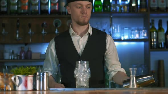 Thumbnail for The Bartender Begins To Prepare an Alcoholic Cocktail.