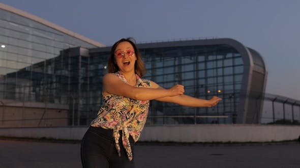 Thumbnail for Happy Woman Tourist Dancing Floss Meme Dance Joyfully, Celebrating Success, Enjoying Music, Sunset