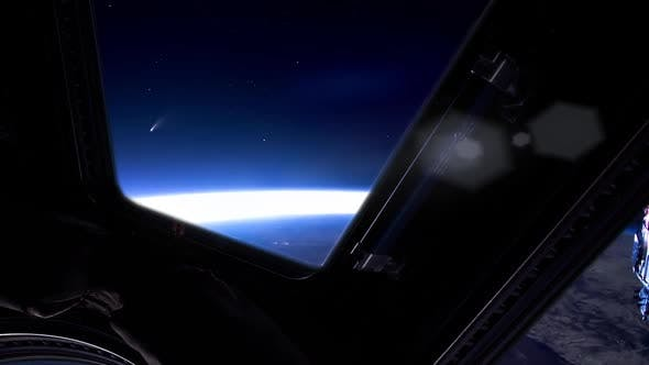 Thumbnail for Comet Neowise rising over the Horizon as seen from the ISS.