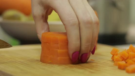 Thumbnail for Female Housewife Hands Slicing Carrots Into Pieces in the Kitchen
