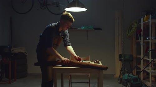 Craftsman Prepares Materials for Work