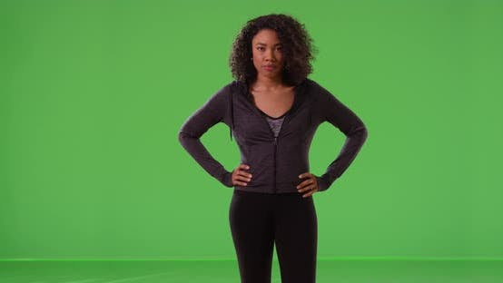 Thumbnail for Strong healthy black woman athlete standing with confidence on greenscreen