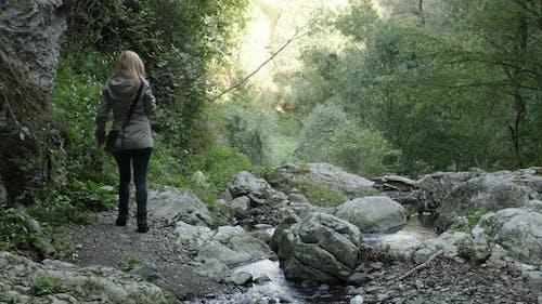 Hiking under natural stone bridge 4K 2160p 30fps UltraHD footage - Beautiful nature of Eastern Serbi