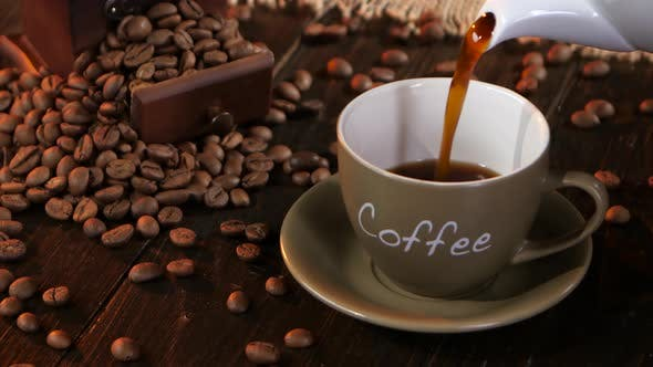 Thumbnail for Coffee in Small Cup on a Saucer on Wooden Table