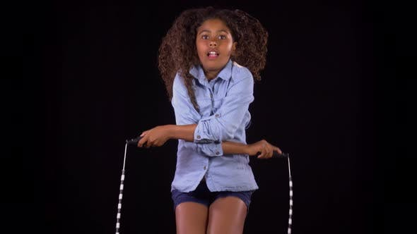 Thumbnail for Cute Girl Jumping Rope In Slow Motion