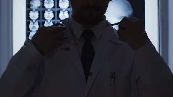 Thumbnail for Doctor putting stethoscope around his neck