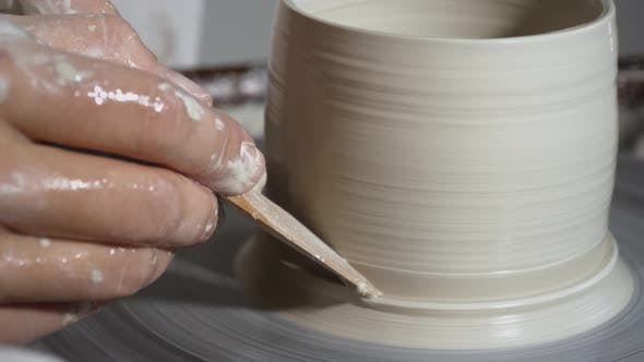 Thumbnail for Clay pot spinning on pottery wheel