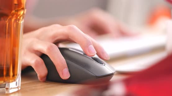 Thumbnail for Hands typing on computer keyboard and use of mouse in office