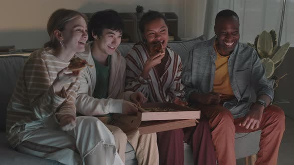 Friends Eating Pizza and Watching TV