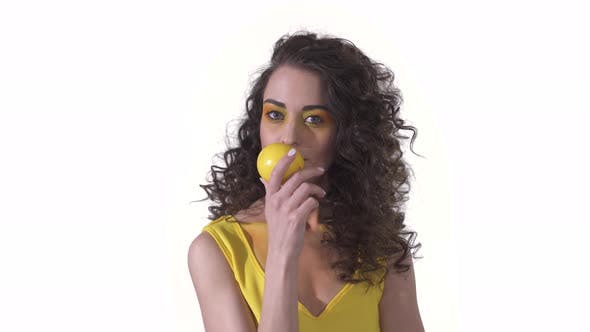 Thumbnail for Portrait of Young Beautiful Curly Girl Sniffing with Pleasure Fragrant Fresh Ripe Lemon Holding It