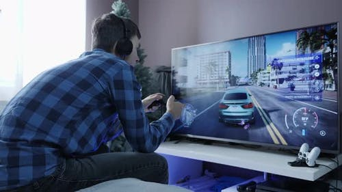 Man playing entertainment gaming competition using joystick.