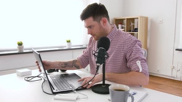 Thumbnail for Man in Headphones with Laptop Speaks To Microphone 57
