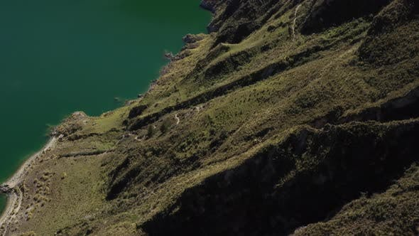 Thumbnail for Aerial view that shows the crater of the quilotoa vulcano and the green lake inside the crater