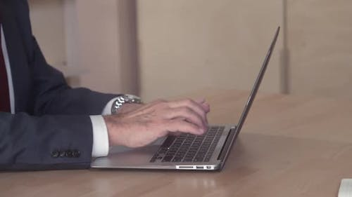 Close Up Person with Necktie Working on PC
