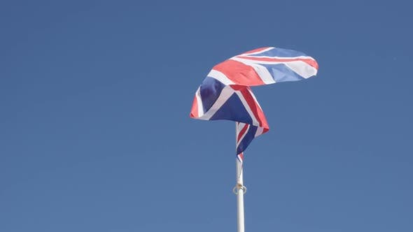 Famous United Kingdom state symbol fabric on flagpole slow-mo 1920X1080 HD footage - Slow motion of