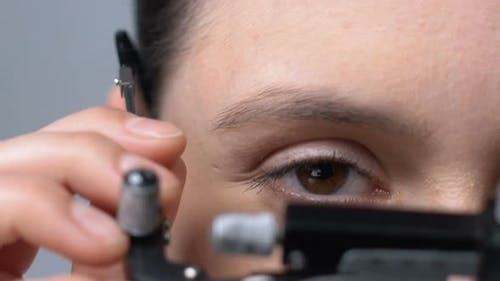 Lady Putting on Ophthalmic Testing Device for Eye Examination and Lens Selection