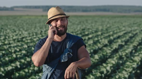 Thumbnail for Farmer Talking on Phone on Field