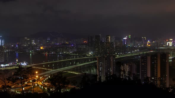 Thumbnail for Macau – Zhuhai Border Earial Cityscape Night Timelapse Pan Up