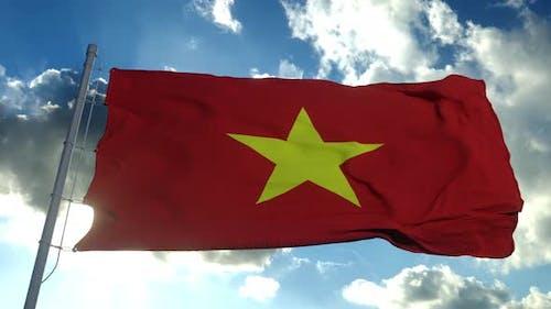 Vietnam Flag Waving in the Wind Against Deep Blue Sky