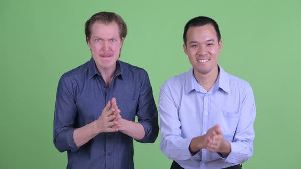 Thumbnail for Two Happy Multi Ethnic Businessmen Getting Good News Together