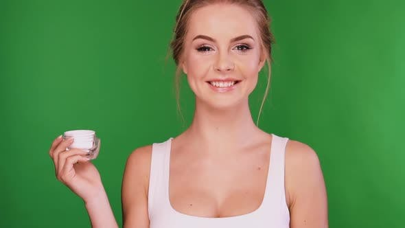 Thumbnail for Girl Applying Cosmetic on Her Breast and Laughing To the Camera