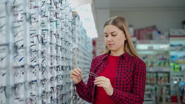 Portrait of a beautiful woman in the eyewear store