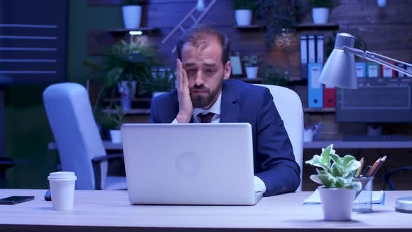 Thumbnail for Overworked Businessman Sits in Front of the Computer