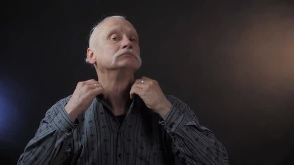 Thumbnail for Retired Person with Mustache Straightens Shirt Collar