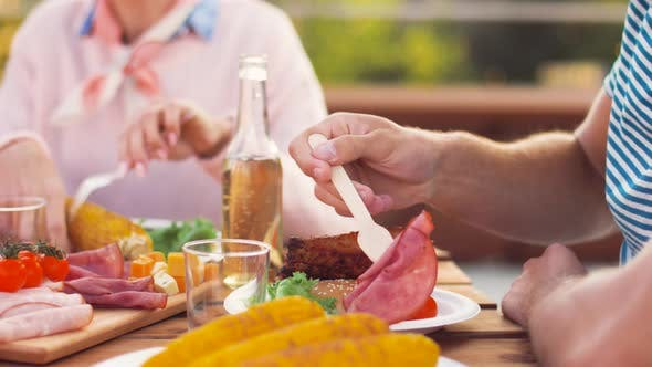 Thumbnail for Man Eating Ham at Bbq or Rooftop Party in Summer 23