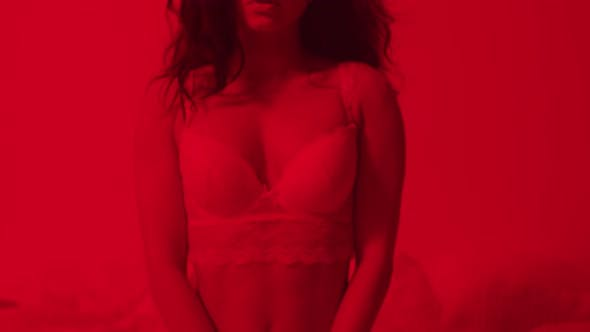 Thumbnail for Closeup Sexy Woman Posing in Bra in Red Light. Provocative Woman in Lingerie