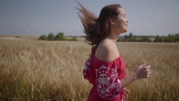 Thumbnail for Side View of Beautiful Carefree Woman with Long Hair Running Through the Wheat Field