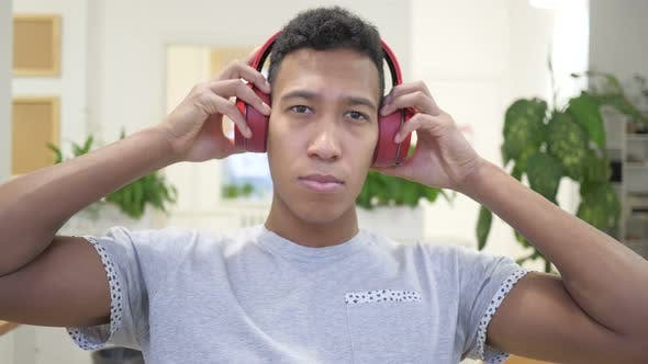 Thumbnail for African Man Wearing Red Headphones for  listening Music