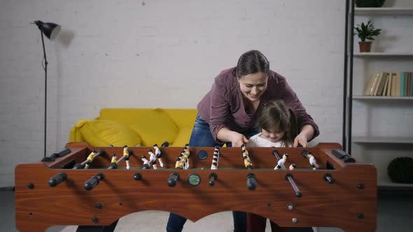 Thumbnail for Happy Carefree Family Playing Table Soccer at Home