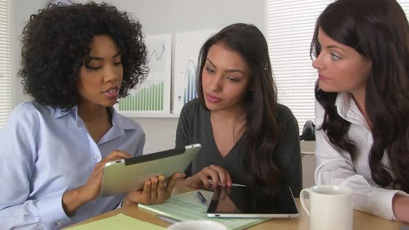 Thumbnail for Three business women using tablet pc together