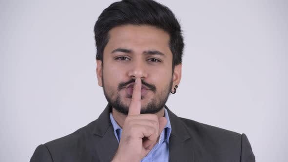 Thumbnail for Young Handsome Bearded Indian Businessman with Finger on Lips