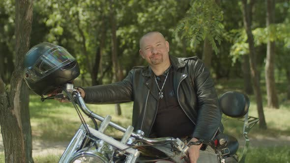 Thumbnail for Lifestyle Portrait of Biker Sitting on Motorcycle