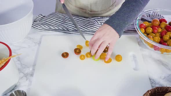 Thumbnail for Step by step. Cutting vegetables on a white cutting board to make a one-pot pasta recipe