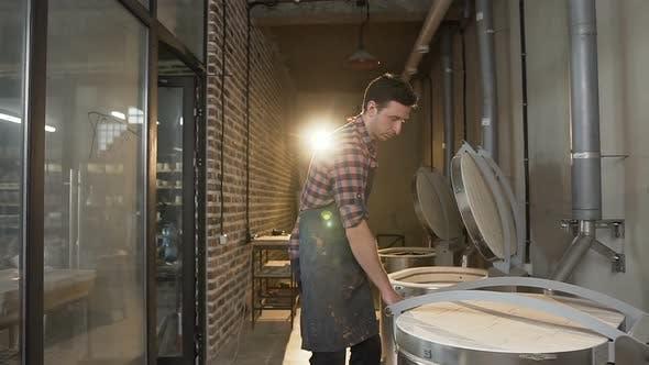 Thumbnail for Caucasian Man Opening Oven for Firing Ceramics Pots