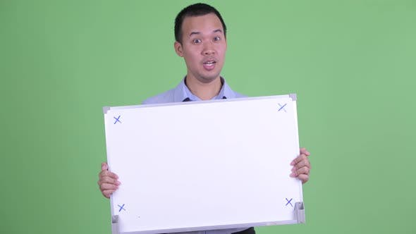 Cover Image for Happy Asian Businessman Holding White Board