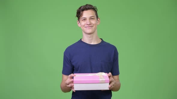 Cover Image for Young Handsome Teenage Boy with Gift Box