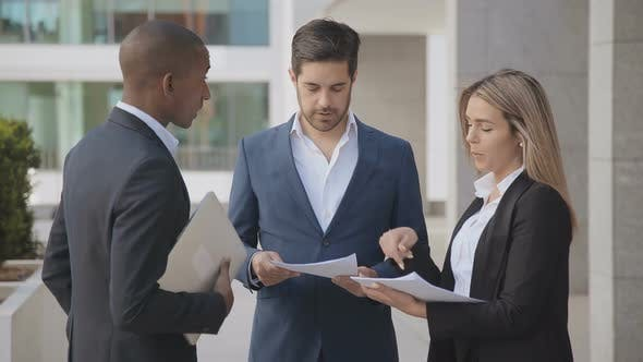 Thumbnail for Professional Business People Discussing Papers Outdoor