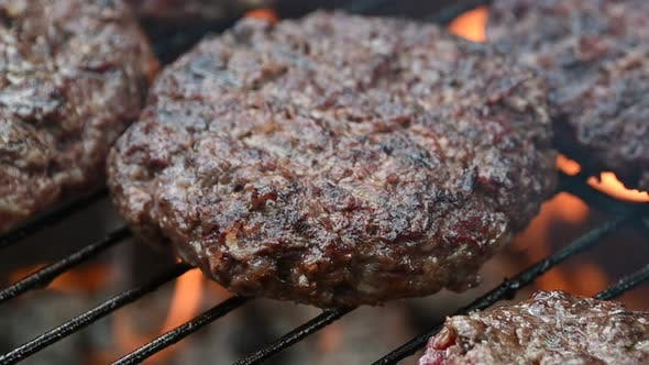 Cooking grilled beef meat barbecue burgers for hamburgers on bbq fire flame grill