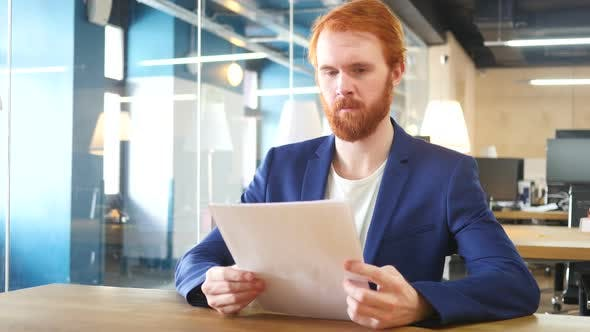 Thumbnail for Man Reading Papers in Office