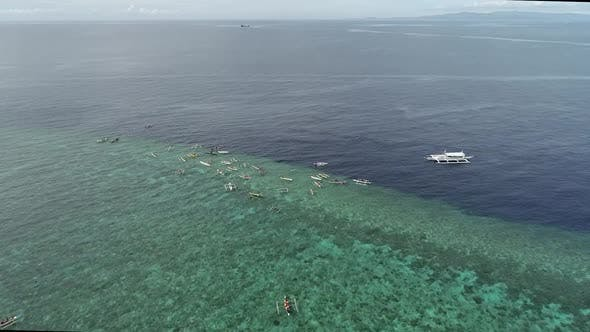 Aerial view of kayaks and people swimming off Balicasag Island, Philippines.